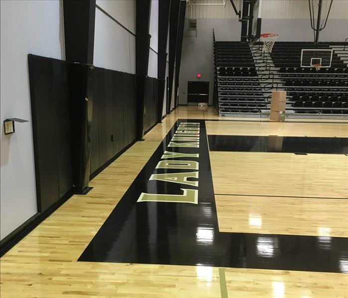 Gym with new flooring post water damage.