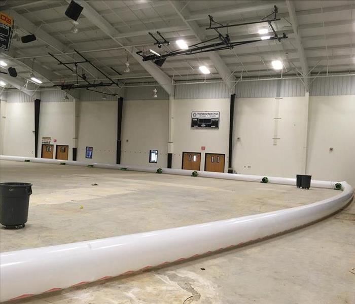 Large gymnasium with drying equipment.