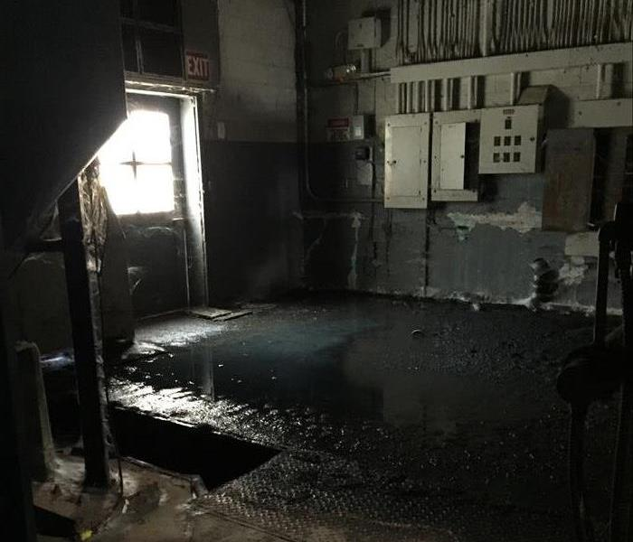 Pool of water in commercial ware house facility.
