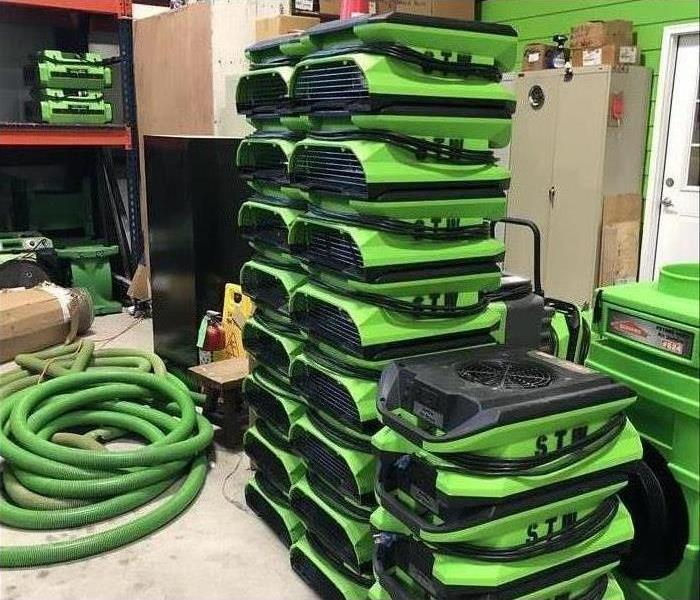 Air movers stacked in a warehouse